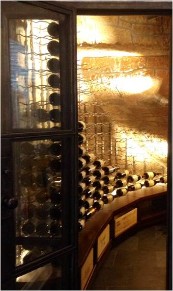 A Small Closet Converted Into A Refrigerated Texas Wine Room