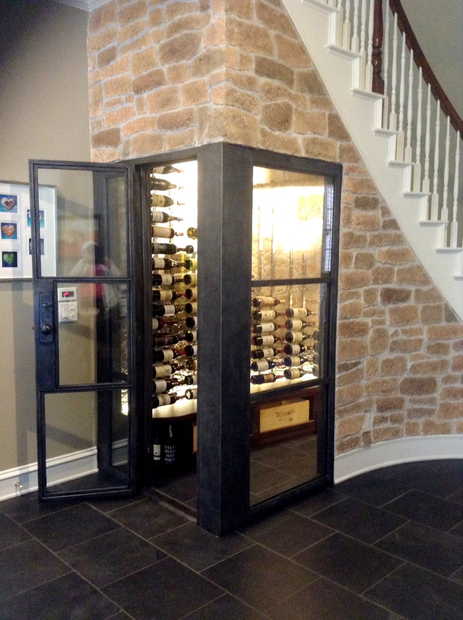 Contemporary Home Wine Cellar Built in a Small Space Under the Stairs