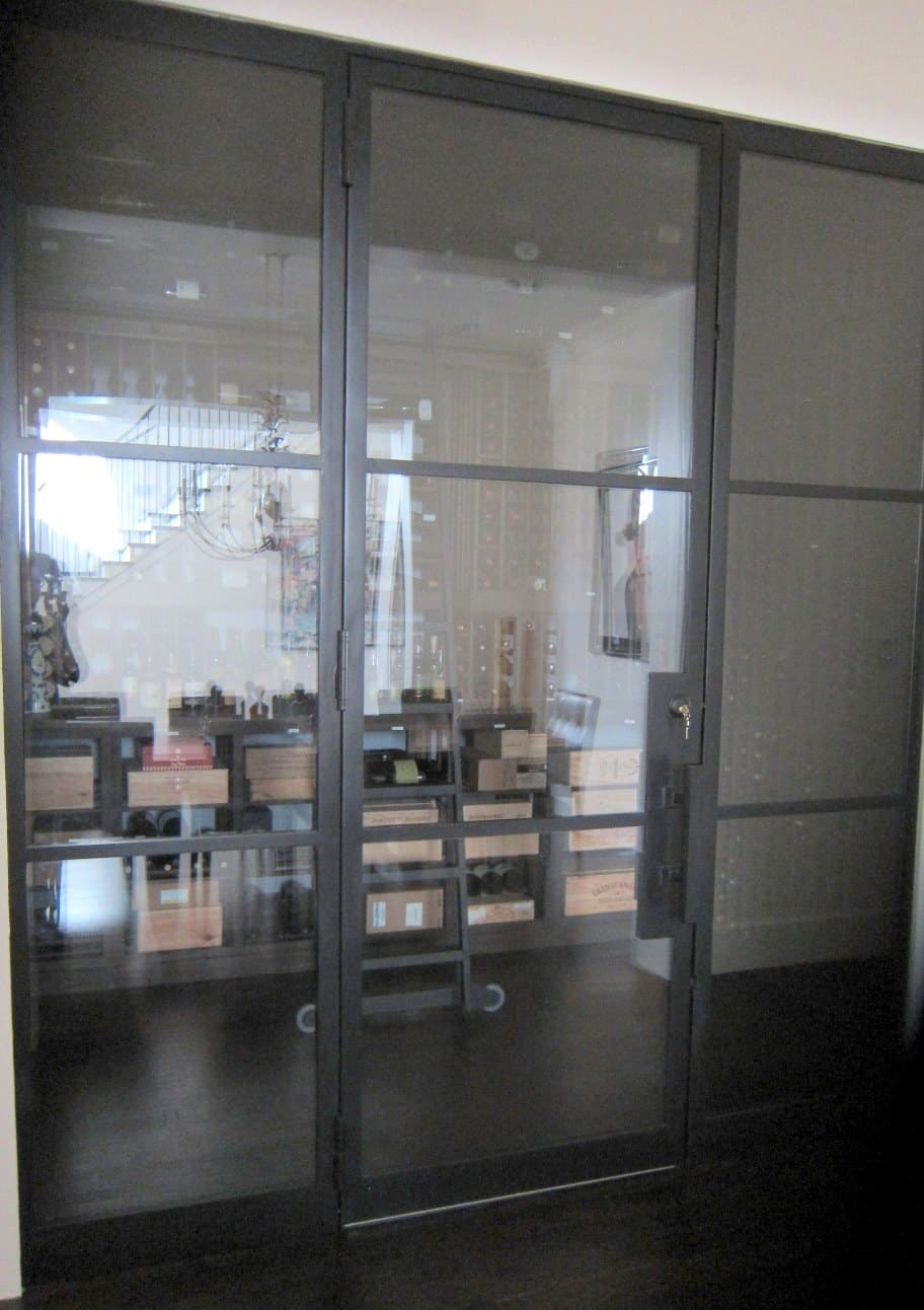 Glass Wine Cellar Door Framed in Iron