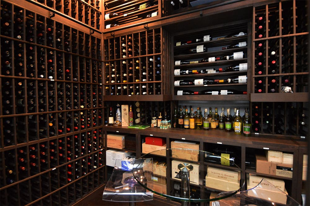 Refrigerated Custom Wine Cellar Racks with Counter Space and Clear Table Dallas TX
